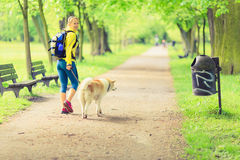 Woman runner walking with dog in summer park royalty free stock photos