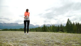 Woman runner warm up outdoor.  stock footage