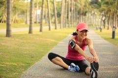 Woman runner warm up outdoor Stock Photos