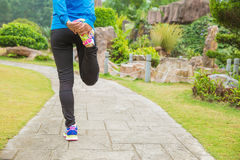 Woman runner warm up outdoor Royalty Free Stock Photos