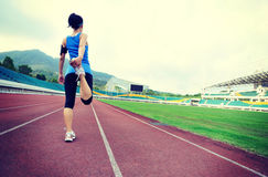 Woman runner warm up Royalty Free Stock Photos
