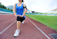 Woman runner warm up Stock Photography