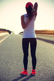Woman runner warm up on road Royalty Free Stock Photos