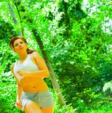 Woman Runner In The Woods Royalty Free Stock Images