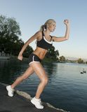 Woman Running. A young woman doing her her daily work out Stock Photo