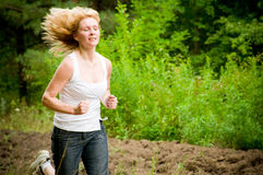 Woman running Stock Photos