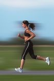 Woman running. Outdoor(motion blur background Stock Photography