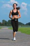 Woman running royalty free stock image
