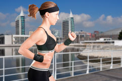 Woman Running. Young fit woman jogging in a modern city Royalty Free Stock Photography