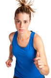 Woman Running. Young fit woman jogging, isolated in a white background Royalty Free Stock Photography
