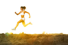 Woman Running. A woman running down a path at the beach Royalty Free Stock Photos