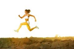 Woman Running. A woman running down a path at the beach Stock Photos