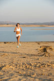 Woman Running. A woman running down a path at the beach Stock Images