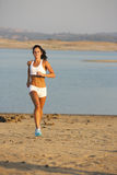 Woman Running. A woman running down a path at the beach Royalty Free Stock Photo