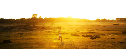 Woman Running. A woman running down a path at the beach Royalty Free Stock Images