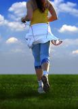 Woman running. Young woman running royalty free stock photo