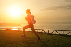 Woman running against the sunset Royalty Free Stock Photography