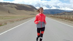 Woman running alone at beautiful sunset on the road. Autumn sport and freedom concept. Athlete training on dusk. 20s 4k. Woman running alone at beautiful sunset stock video footage