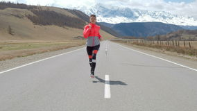 Woman running alone at beautiful sunset on the road. Autumn sport and freedom concept. Athlete training on dusk. 20s 4k.  stock video