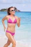 Woman Running Along The Beach Stock Photography