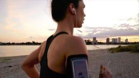 Woman running along beach stock video