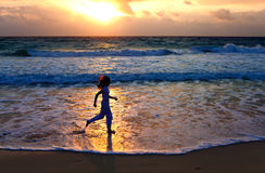 woman running  along ocean coast Stock Photography