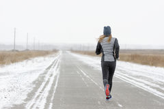 Woman running along in the winter. Reinforced training and Marat Royalty Free Stock Photo