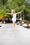Woman Running Along Wooden Jetty Royalty Free Stock Photos