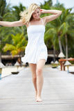Woman Running Along Wooden Jetty Royalty Free Stock Photography