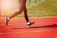 Woman running around the track Stock Photography
