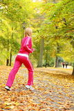 Woman running in autumn forest.  Female runner training. Stock Image