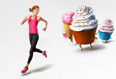 Woman running away from sweets. Woman running away from large sweets isolated Stock Image