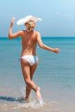 Woman running on beach Royalty Free Stock Photos