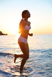 Woman is running on the beach Royalty Free Stock Photography