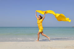 Woman running on beach Stock Photos