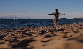 Woman running on beach Stock Photos