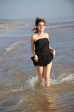 Woman running at the beach Royalty Free Stock Photography