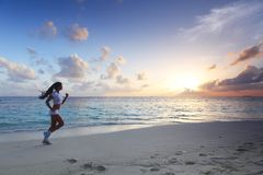 Woman running on beach Royalty Free Stock Images