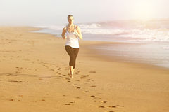 Woman running beach Stock Photo