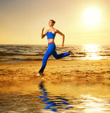 Woman running on a beach Royalty Free Stock Photography