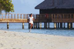 Woman running on beach Royalty Free Stock Photo