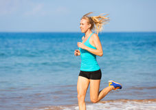 Woman running on beach Royalty Free Stock Photography