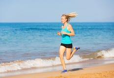 Woman running on beach Stock Photography