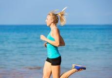 Woman running on beach Royalty Free Stock Image
