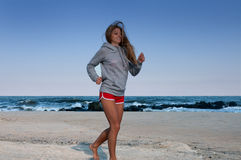 Woman running on the beach, fitness and weight loss Stock Photography