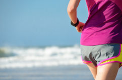 Woman running on beach, girl runner jogging outdoors Royalty Free Stock Image