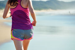 Woman running on beach, girl runner jogging outdoors Royalty Free Stock Photography