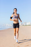 Woman running beach Royalty Free Stock Photo