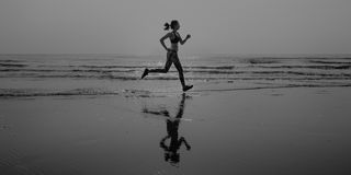 Woman Running Beach Morning Exercise Concept royalty free stock image