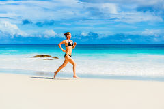 Woman running on the beach. Photo of a woman running on the beach Royalty Free Stock Photography
